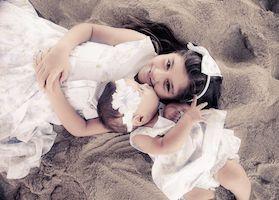 sister posing on the beach