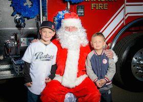 Santa posing with kids