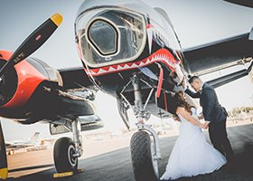 Bride and Groom in front of an air plane