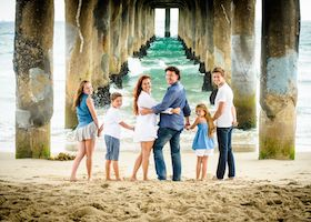 Family Portrait at beach under pier
