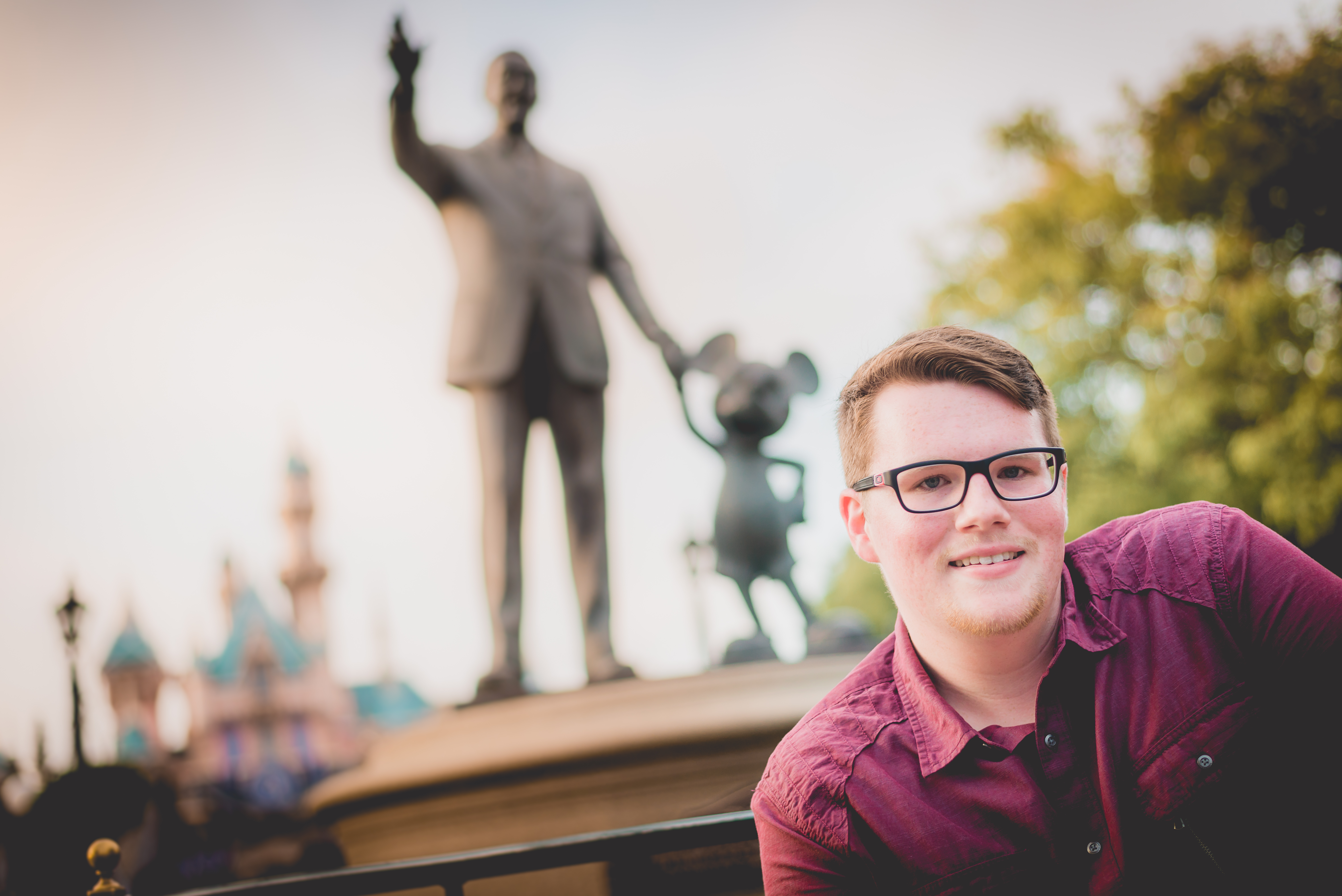 Senior Portrait with Walt Disney and Mickey in the back
