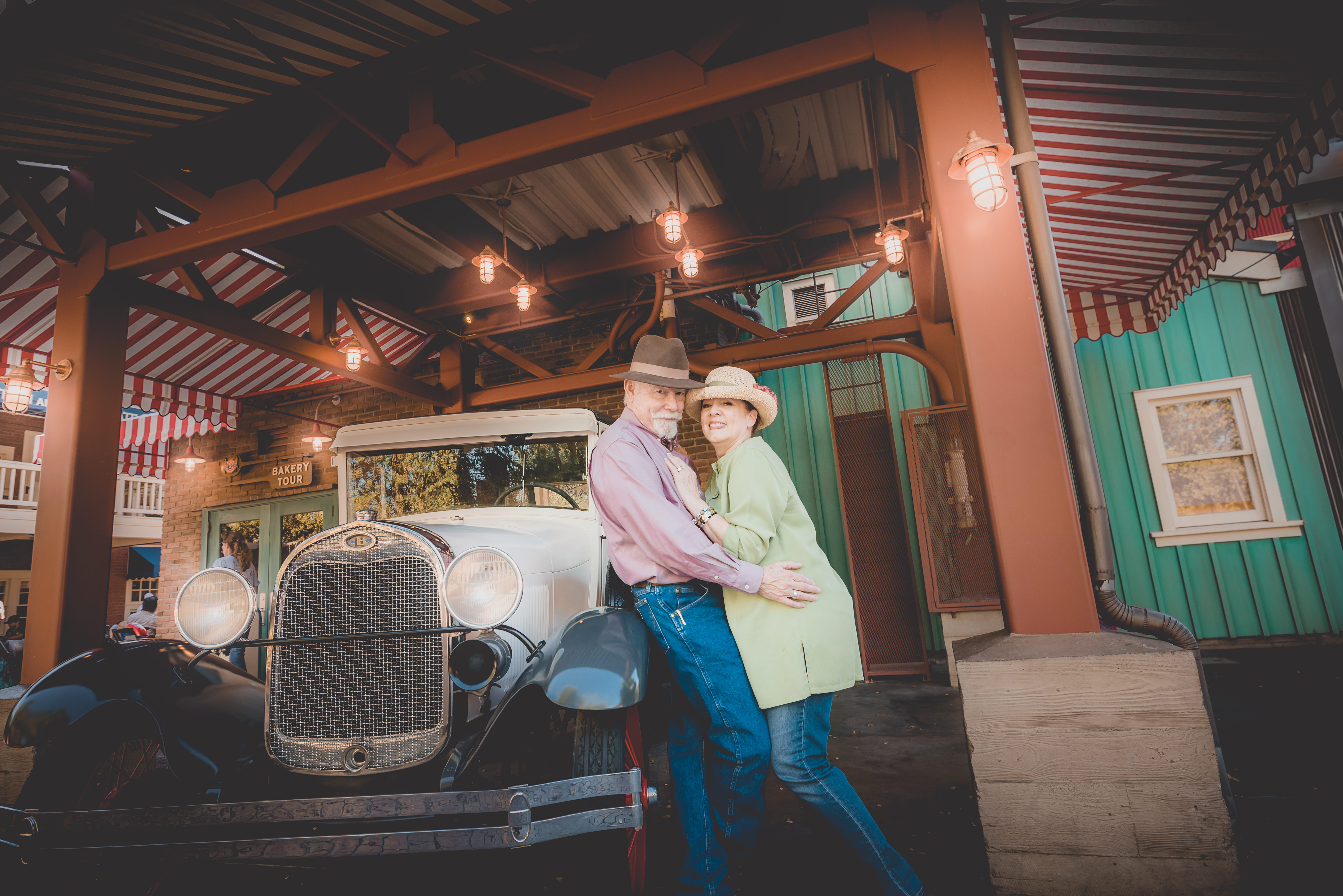 Wagner Couple next to a classic car in California Adventure