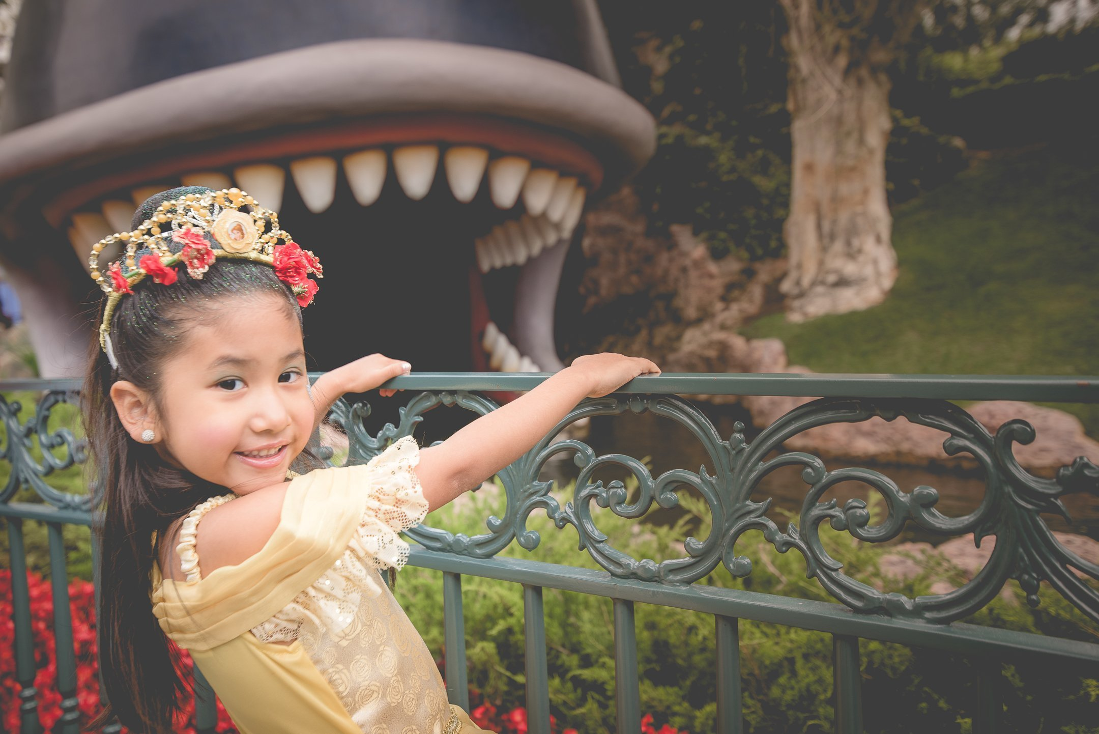 Girl with princess dress by the Storybook ride in Disneyland, CA