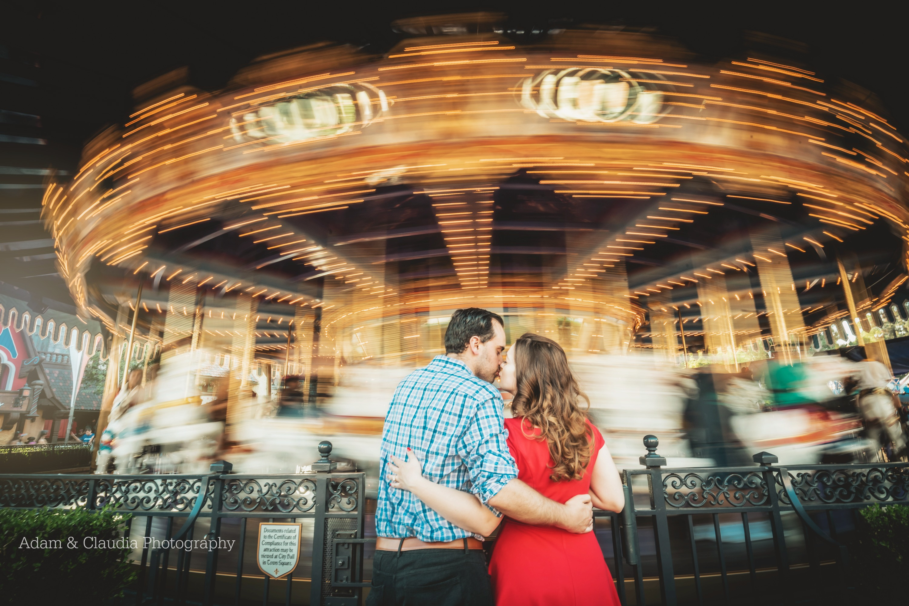 Engagement photo in front of disney carousel