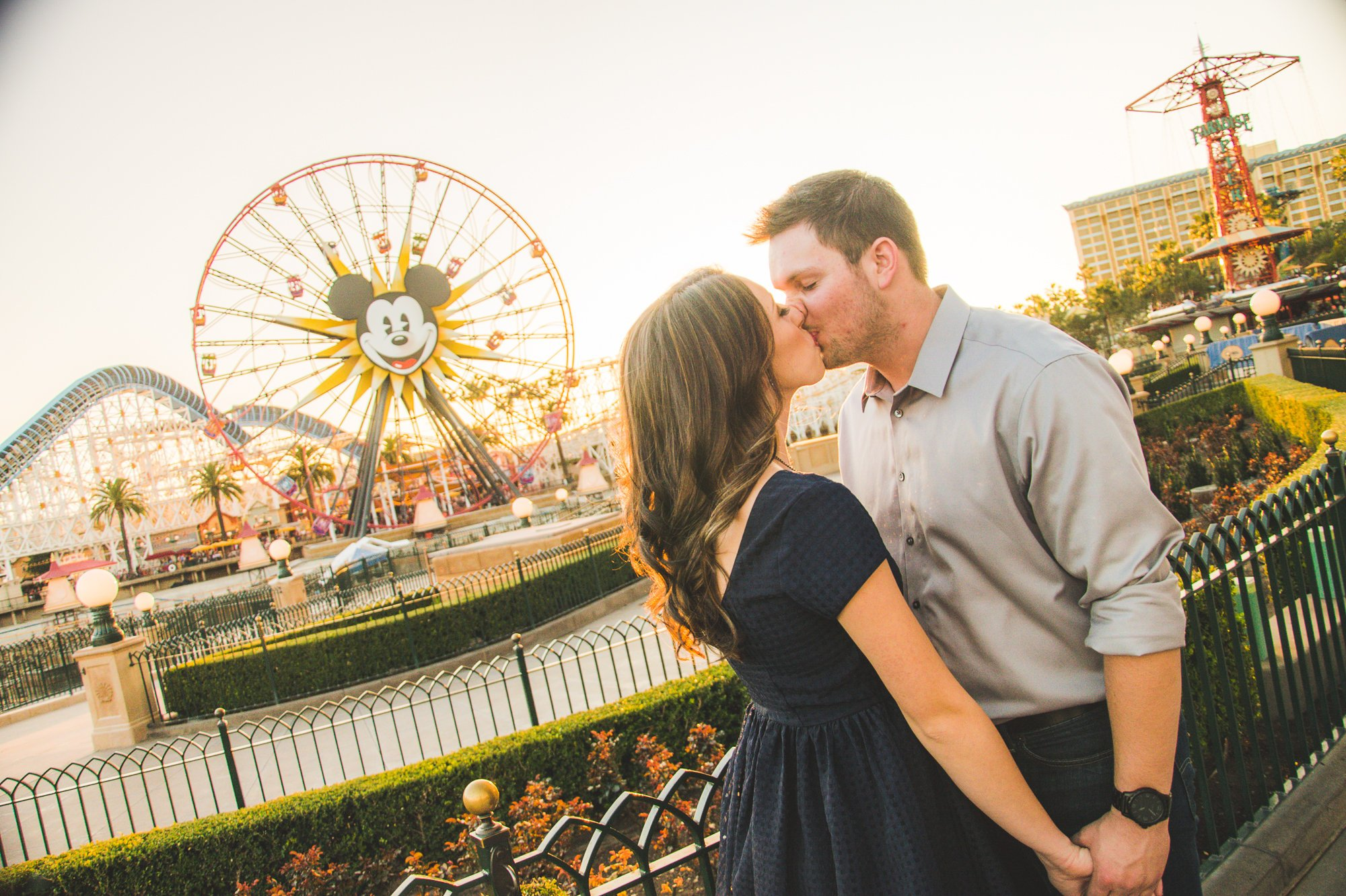Mehlberg couple kissing in front of Ferris Wheel