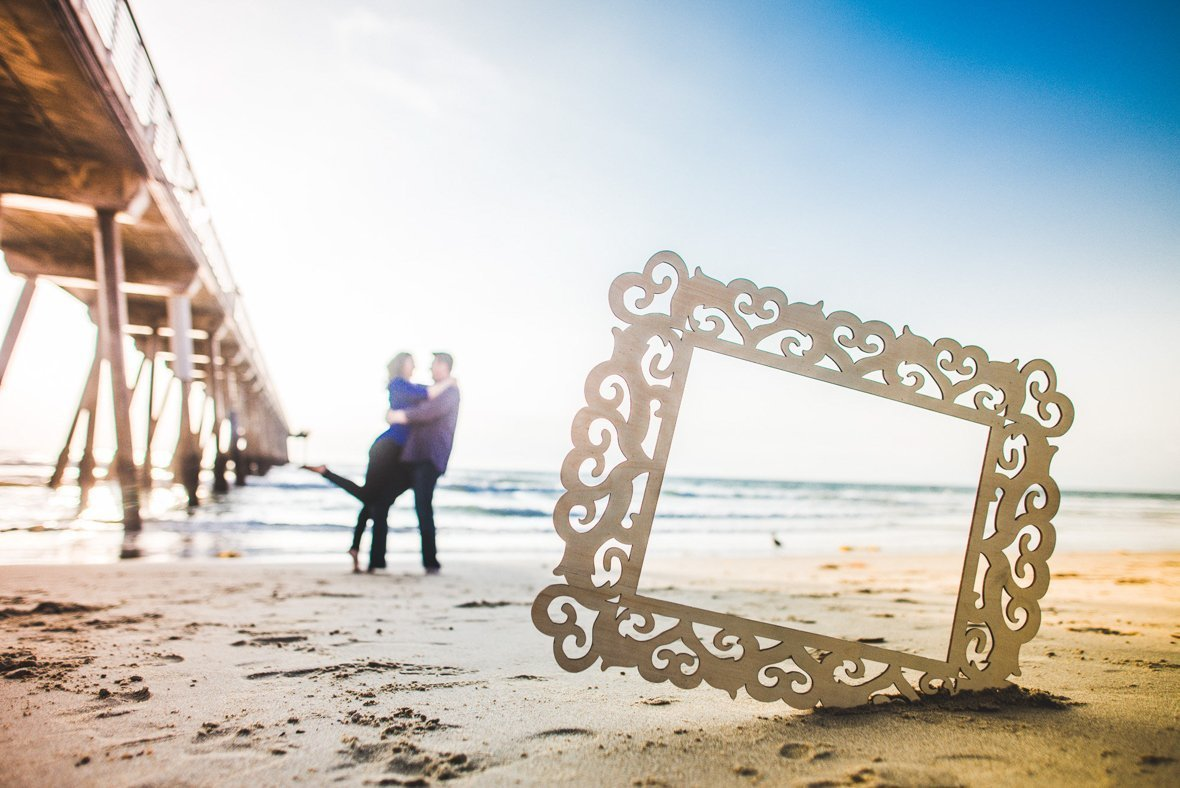 couple on the beach with a picture frame