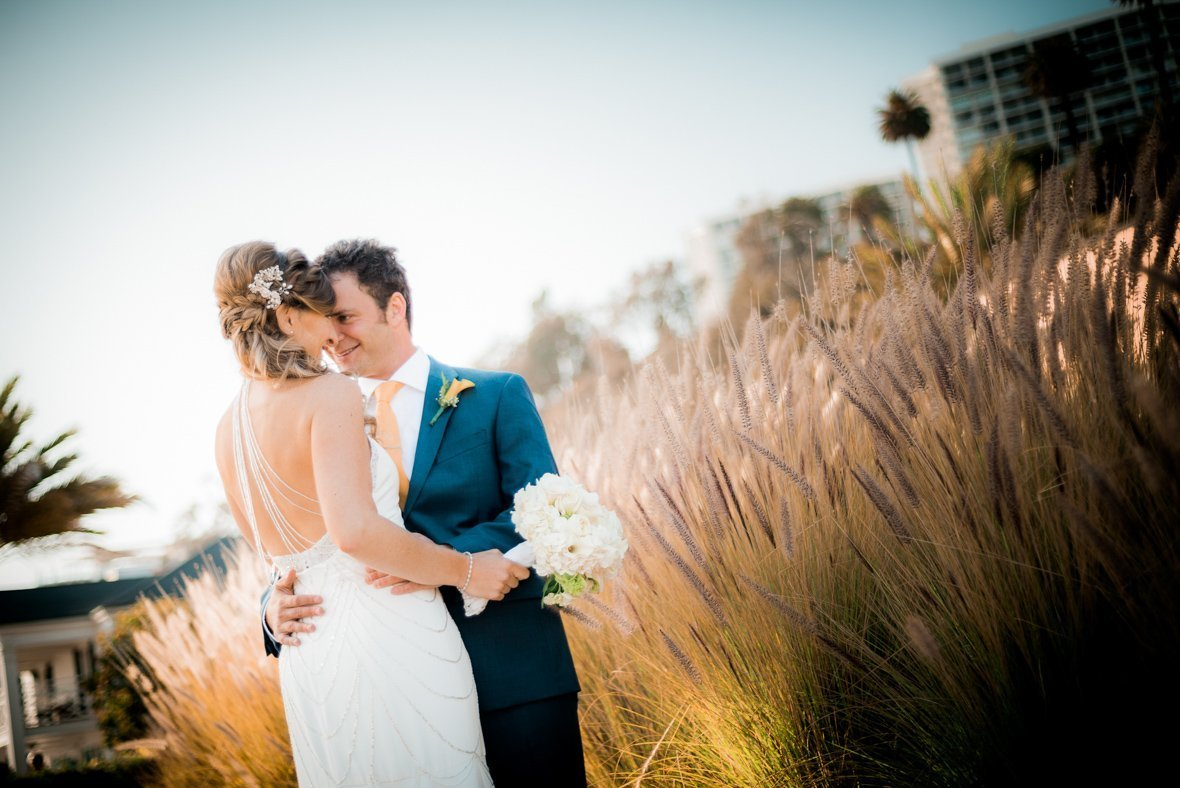couple by some tall grass