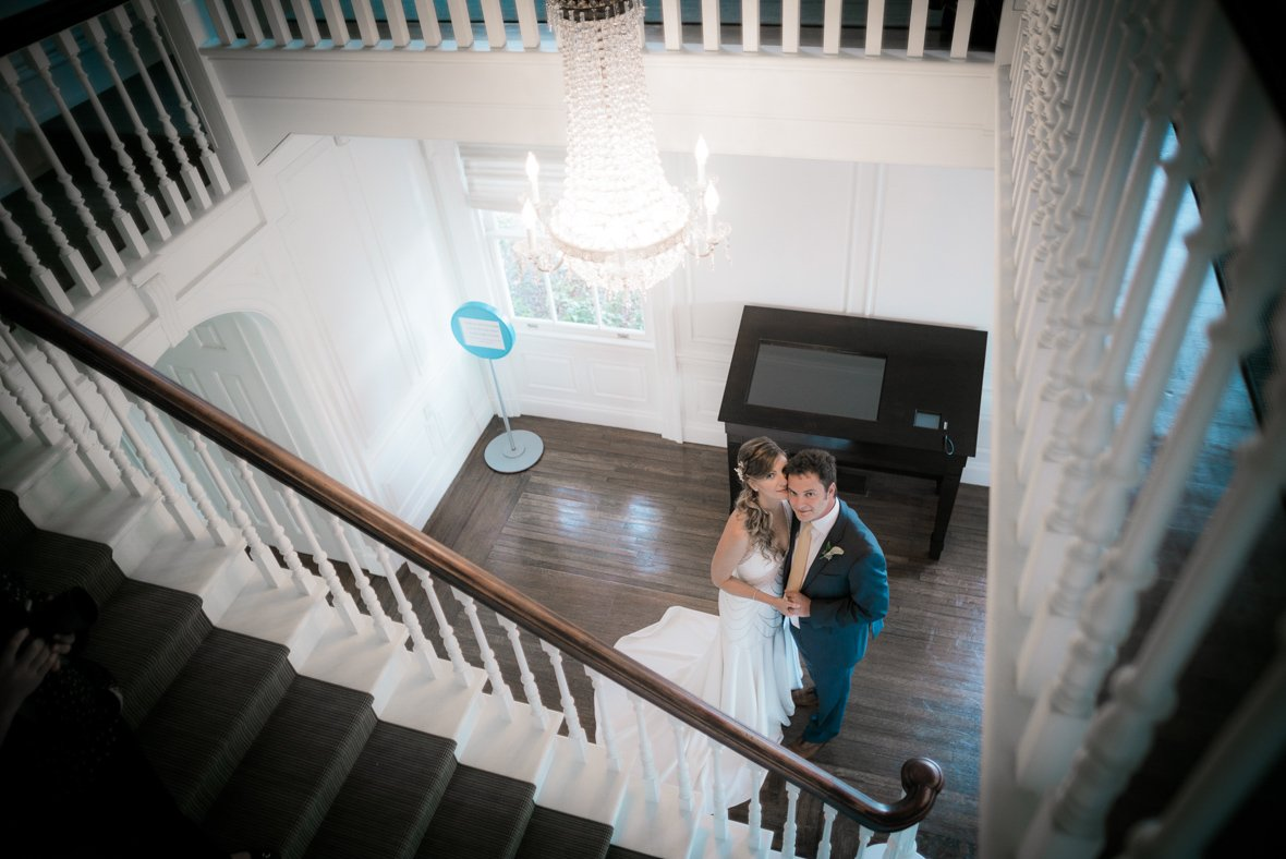 couple standing at the bottom of the stairs