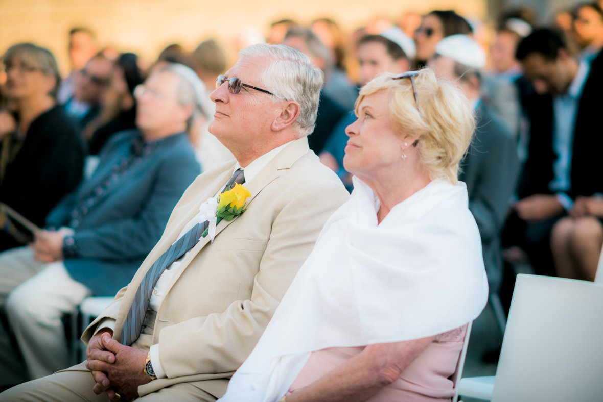 parents sitting during the wedding