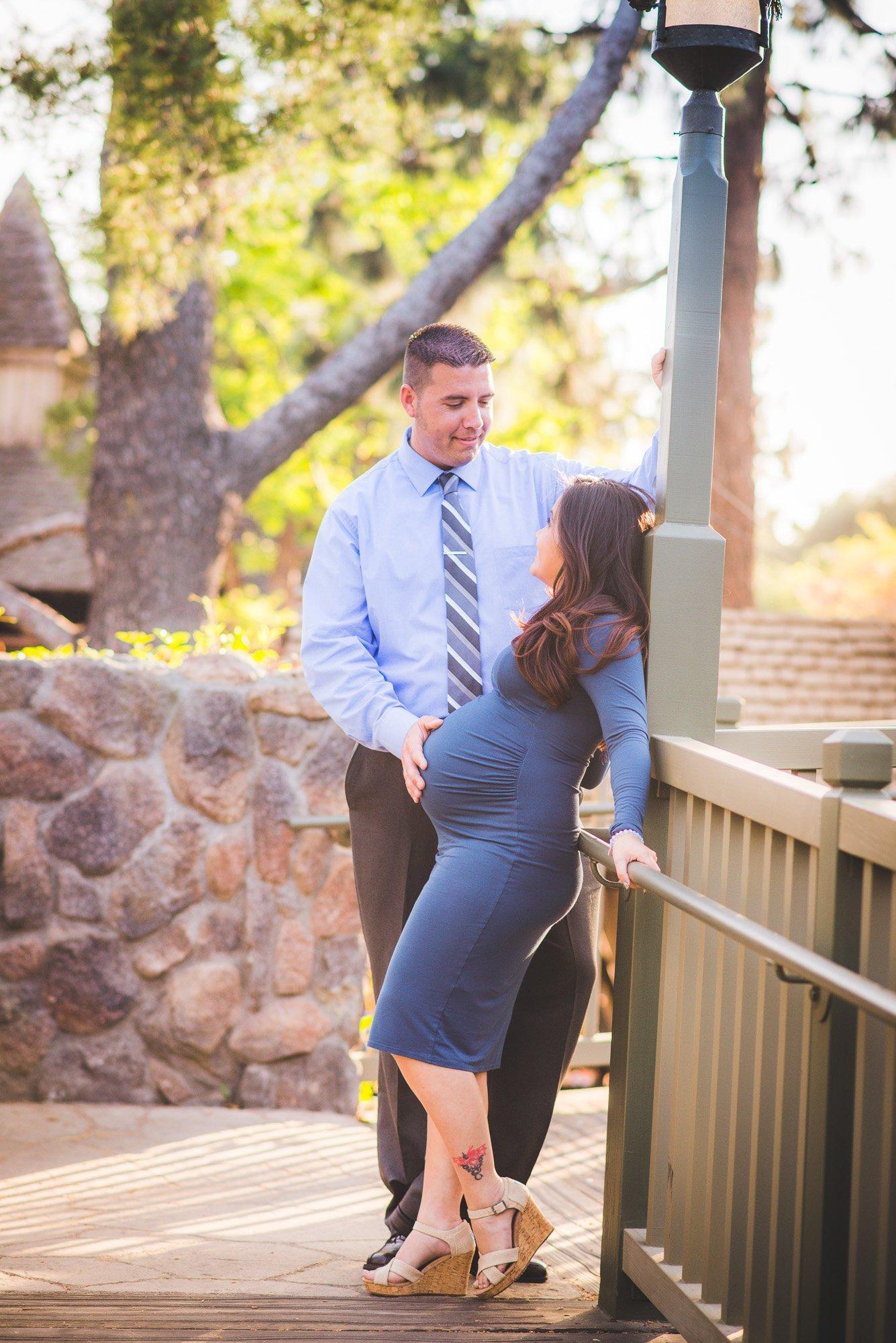 couple standing on a bridge