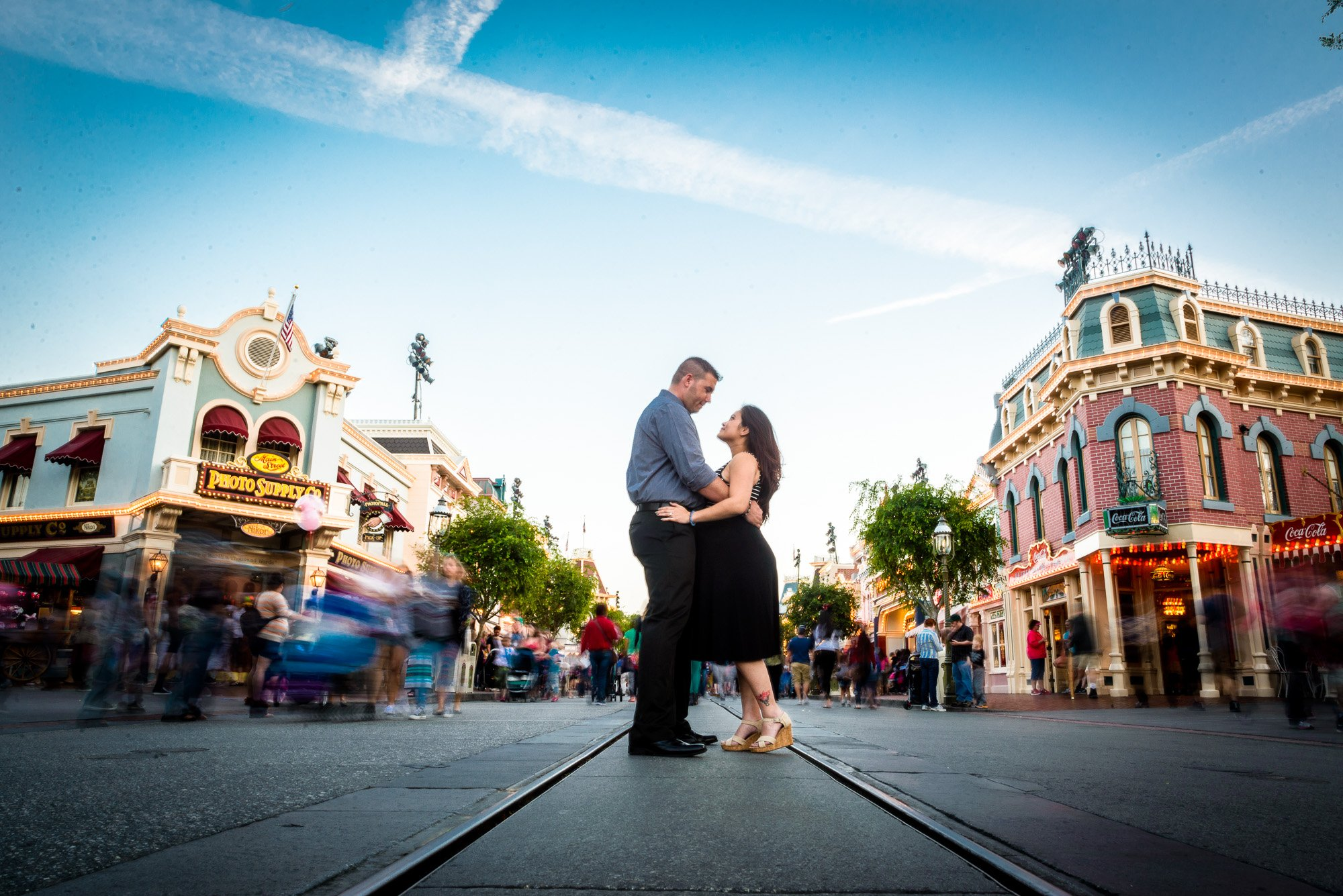 couple standing in the middle of Disney's main street