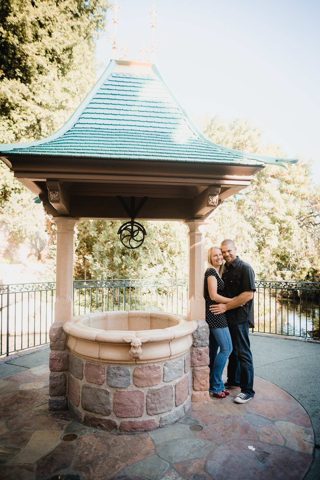 couple standing by a well
