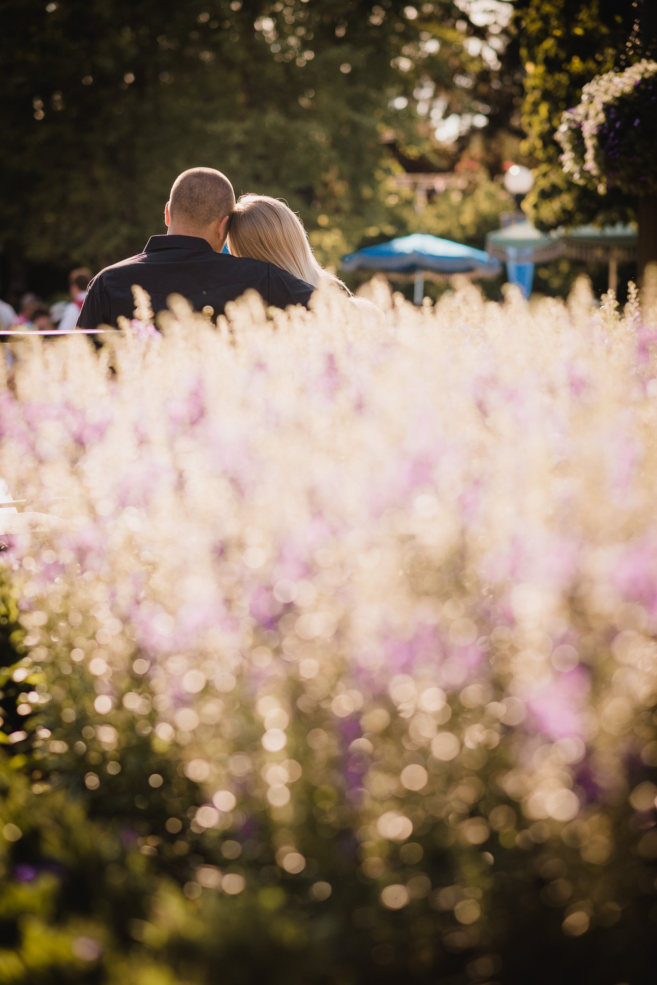 Couple walking with some flowers