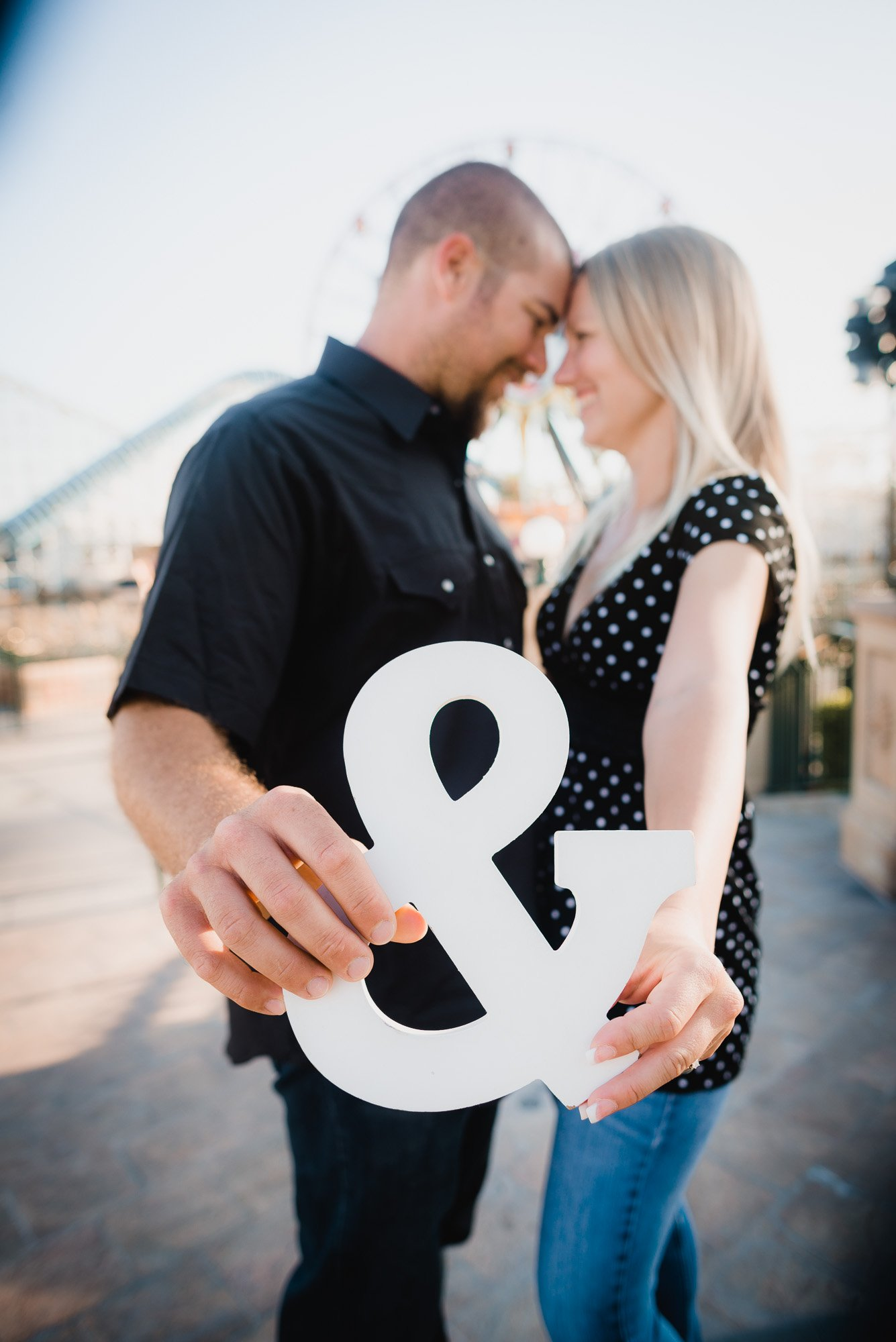 couple standing together with white and sign