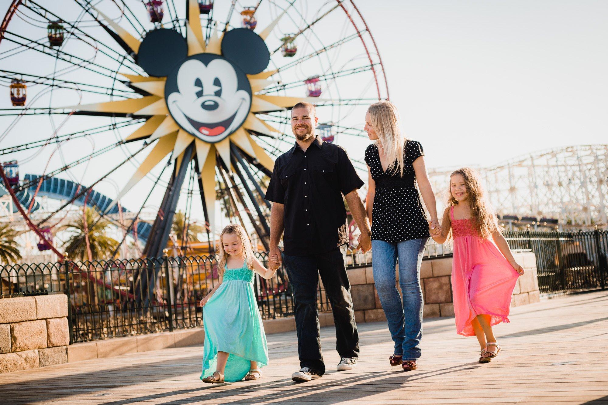 Family walking by the ferris wheel