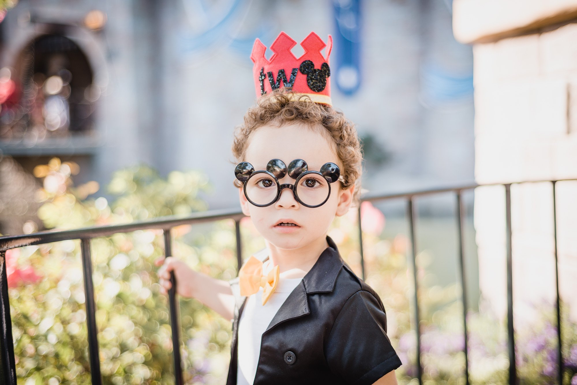 Diaz child with a crown and glasses