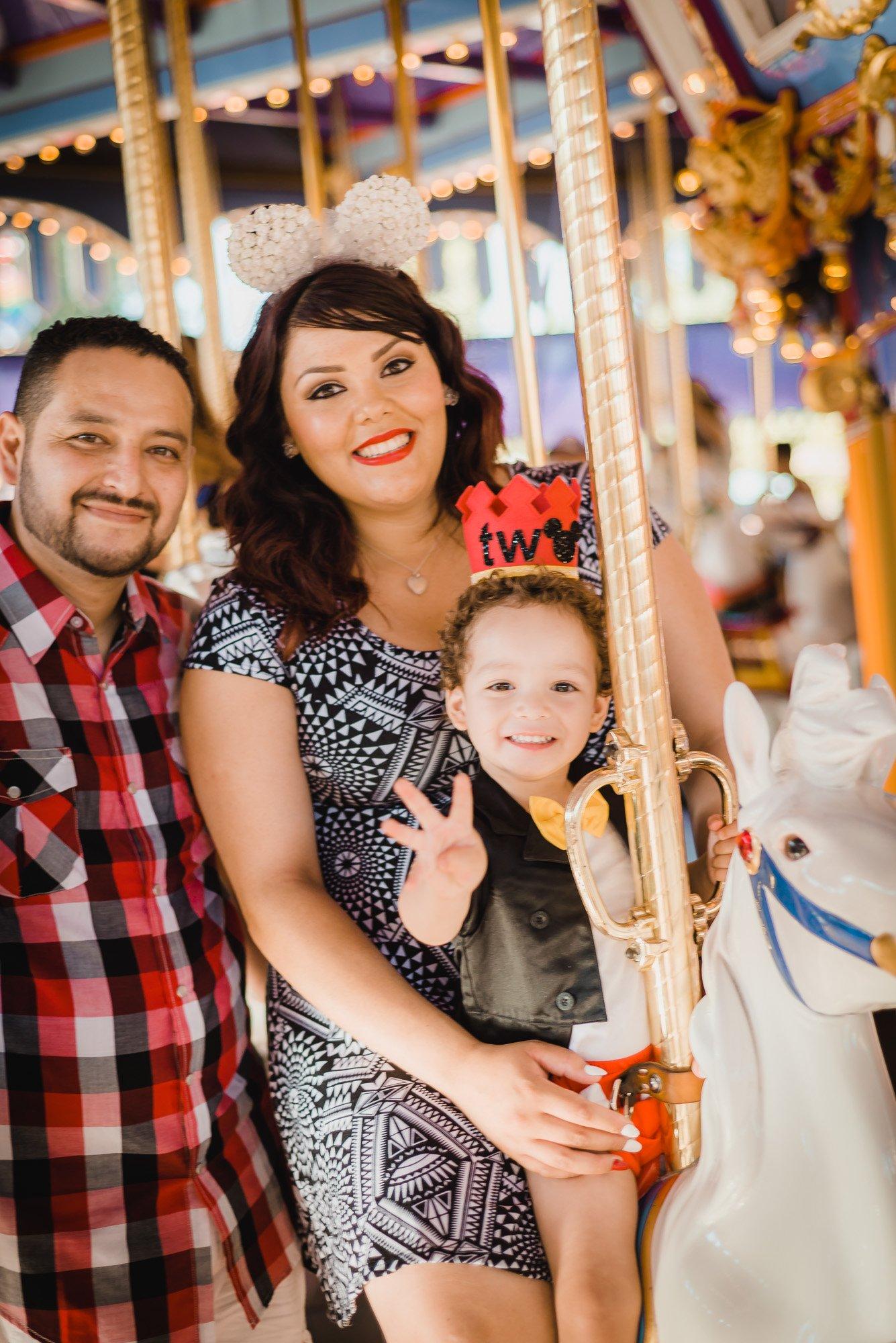 Diaz family on a carousel
