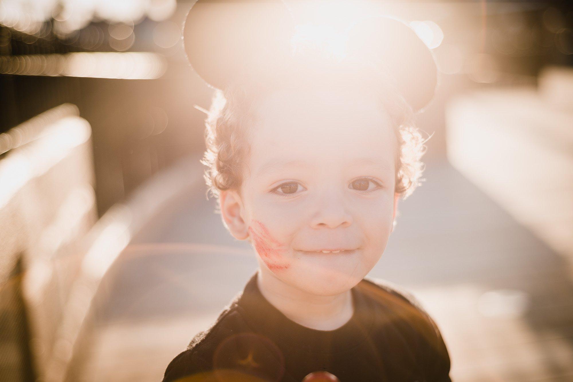 Diaz child wearing Mickey ears