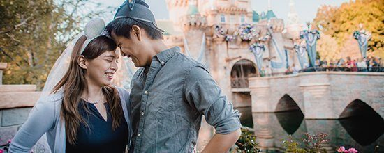 Photographer Picturing Couple At Disneyland
