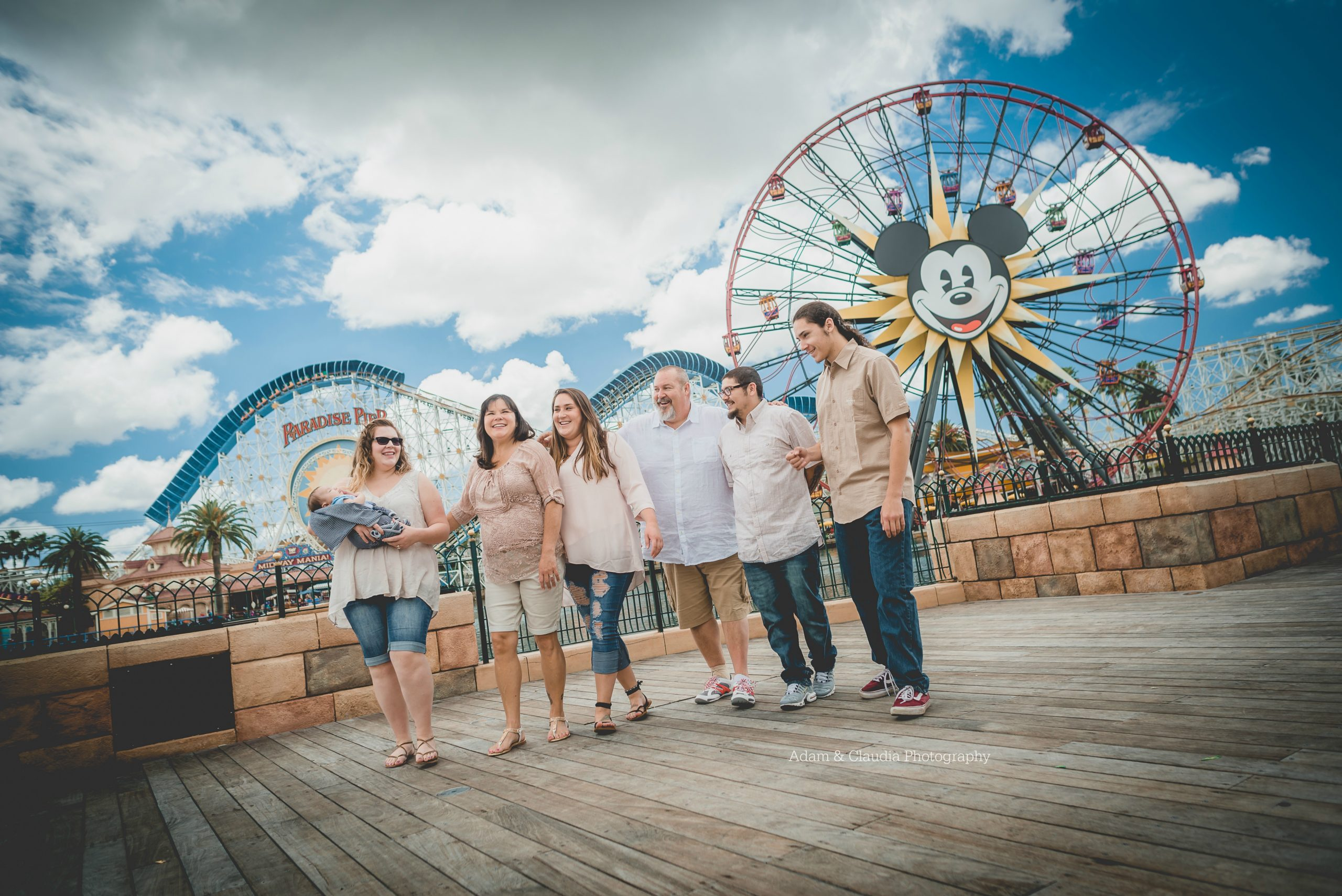 Family in front of Mickey Wheel
