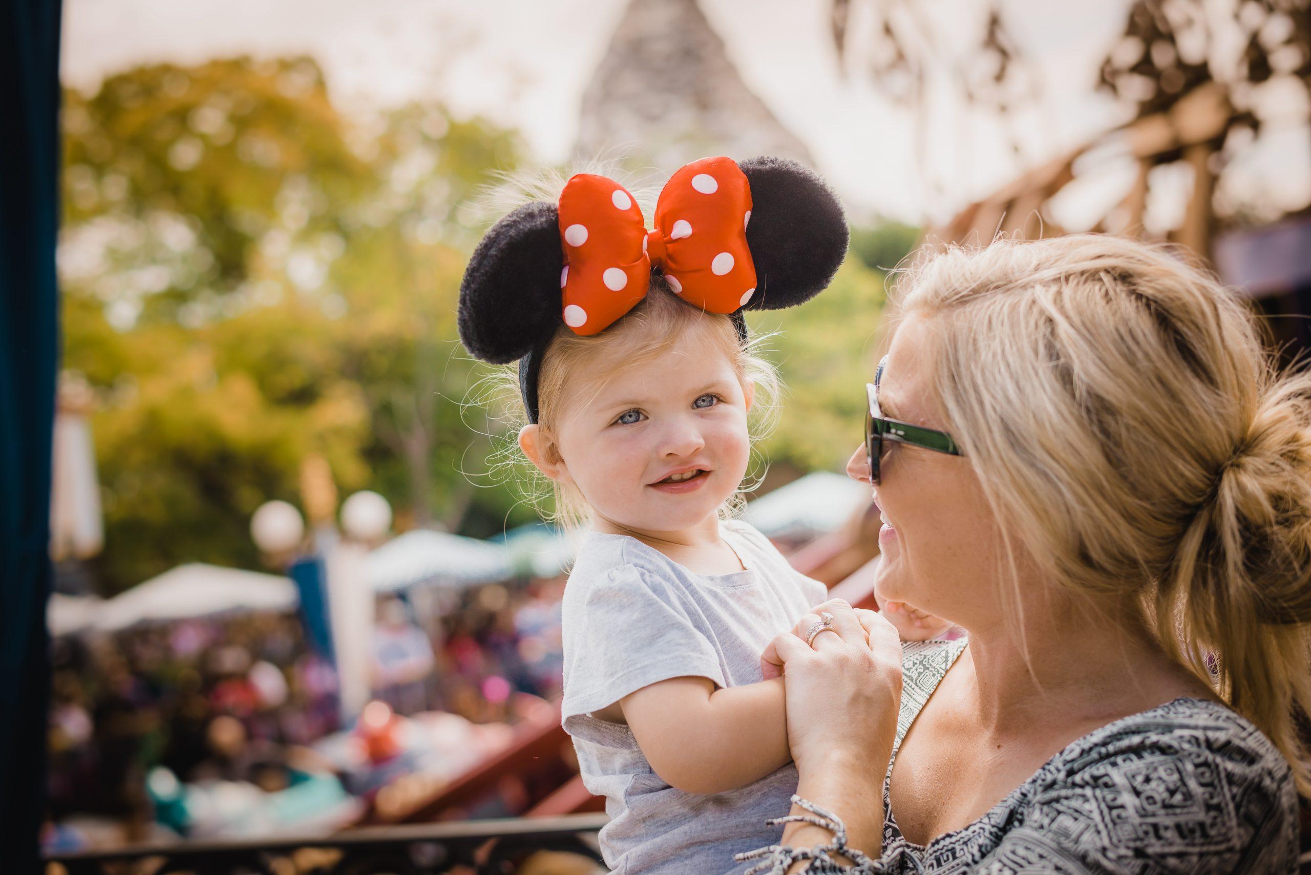 Little girls smiling at Disneyland