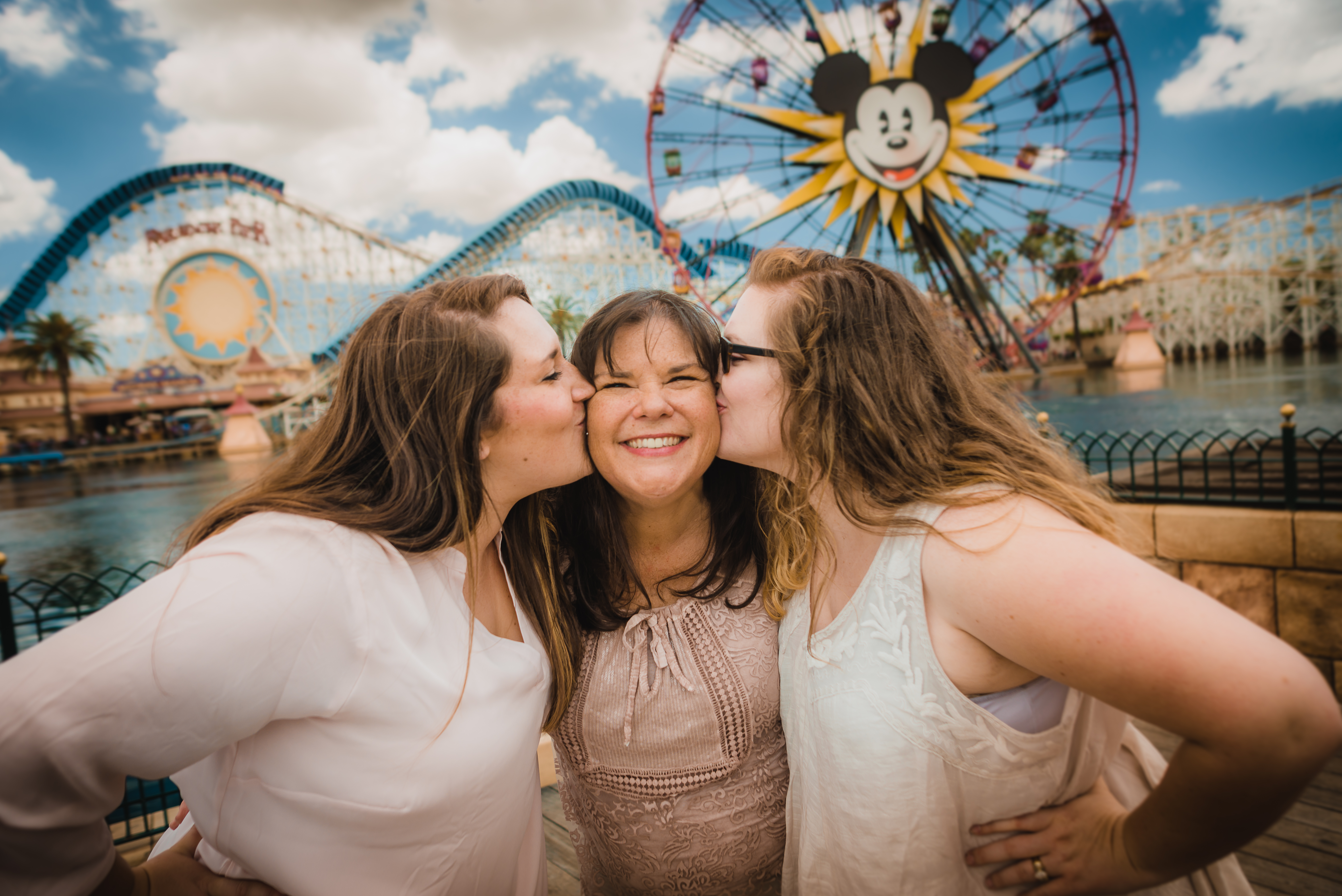 Mom and her daughters at the mickey wheel in California Adventure