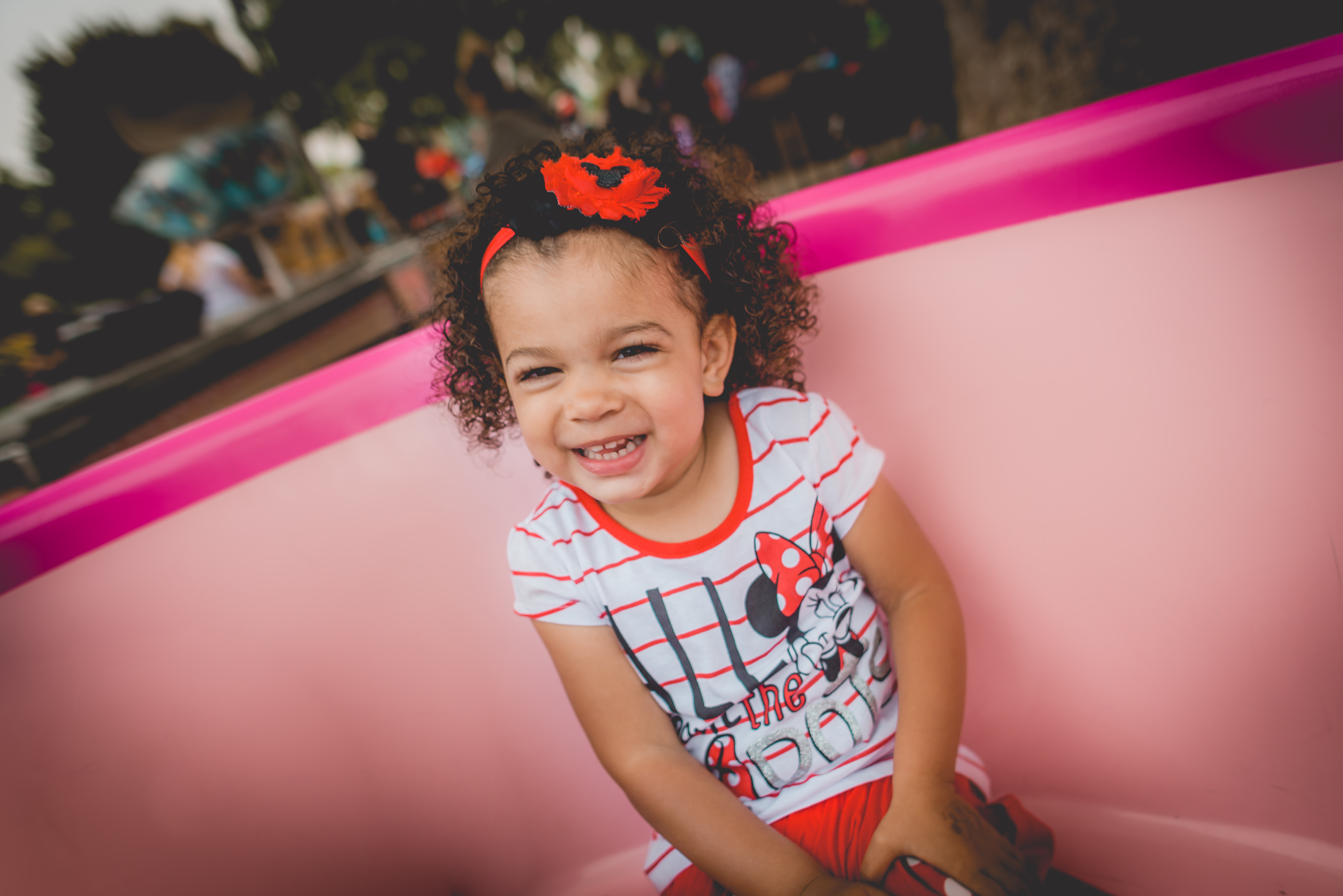 Little girl sitting in the tea cup at Disneyland