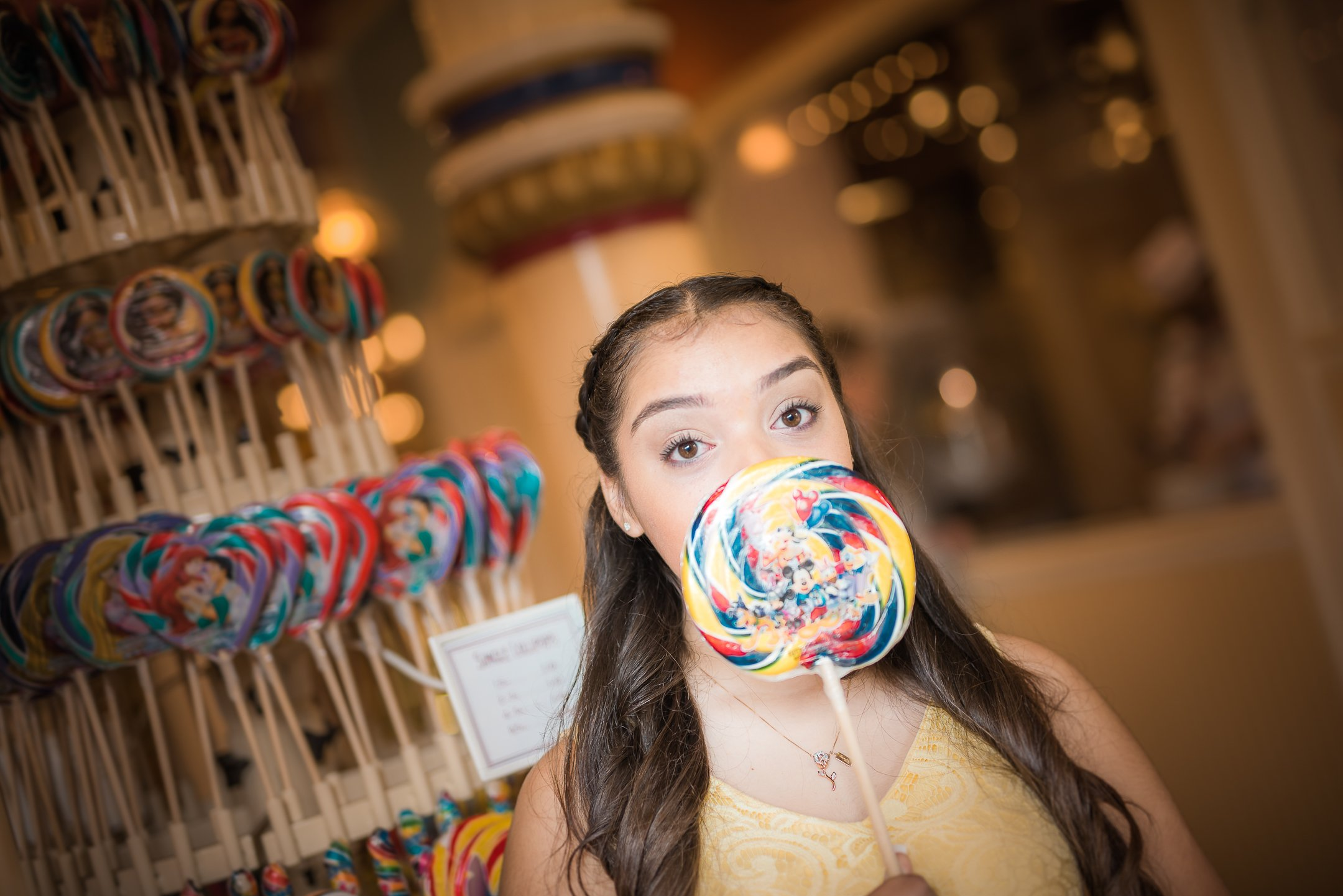 Disneyland Quinceanera photo session - In the penny arcade on Main Street USA