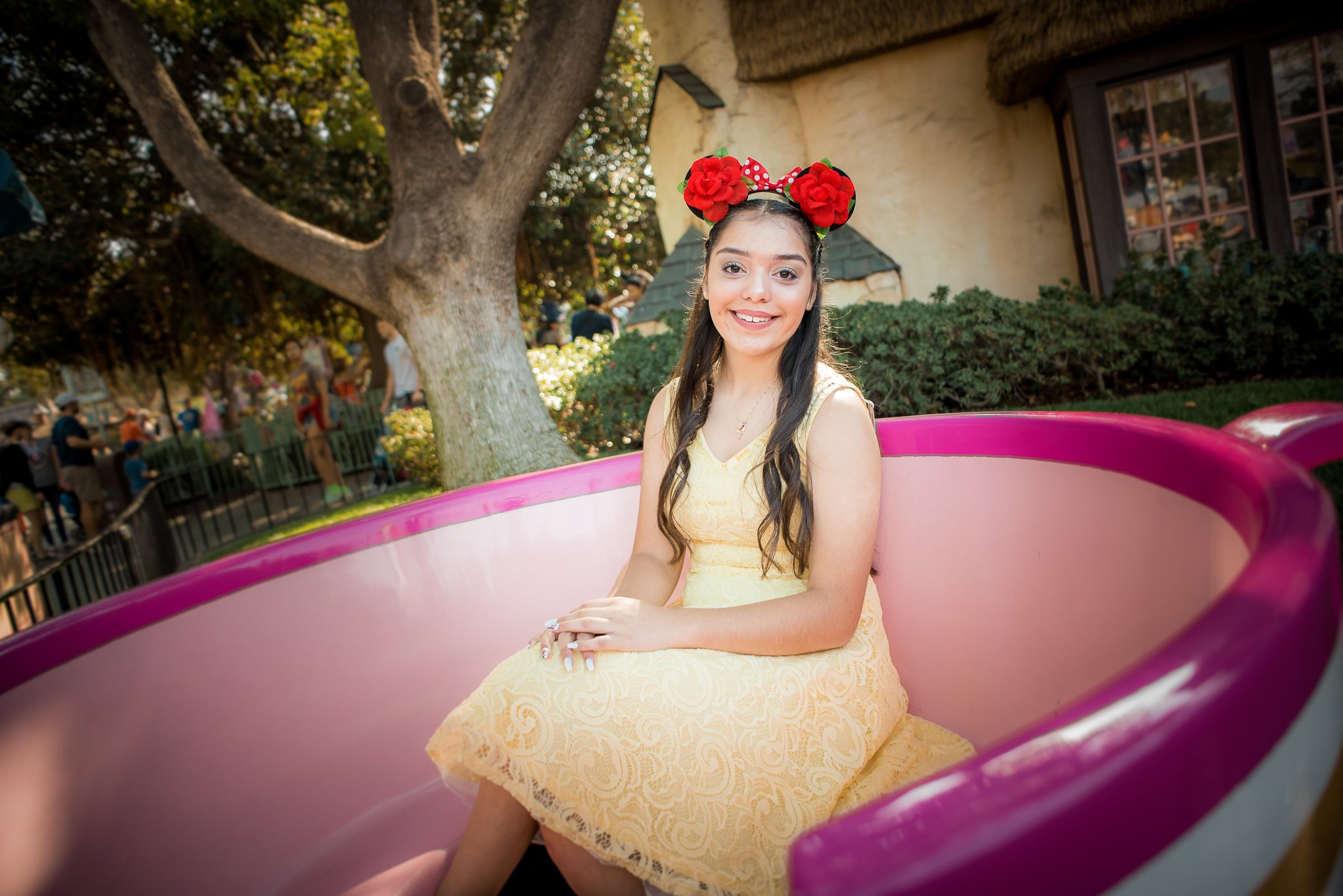 Disneyland Quinceanera photo session - In the stationary teacup by the Mad Tea Party in Disneyland, CA