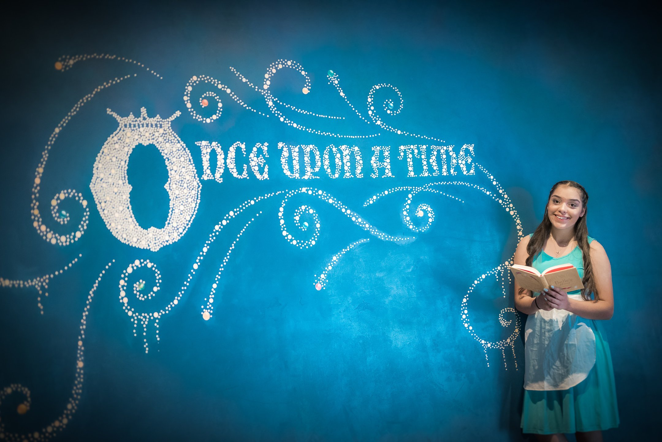"Disneyland Quinceanera photo session - In front of the blue wall that says ""once upon a time"""