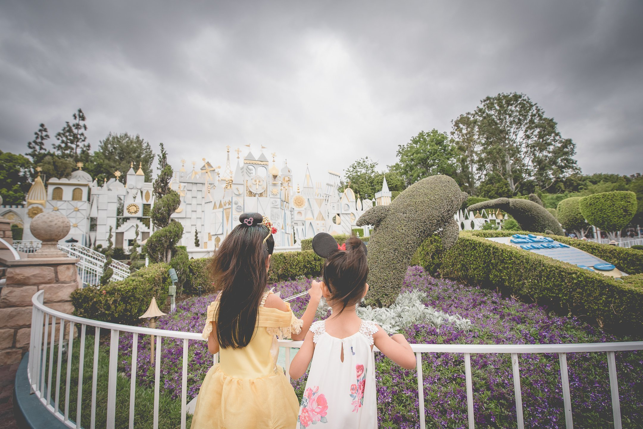 Photo of Sisters by the It's a small world ride in Disneyland, CA