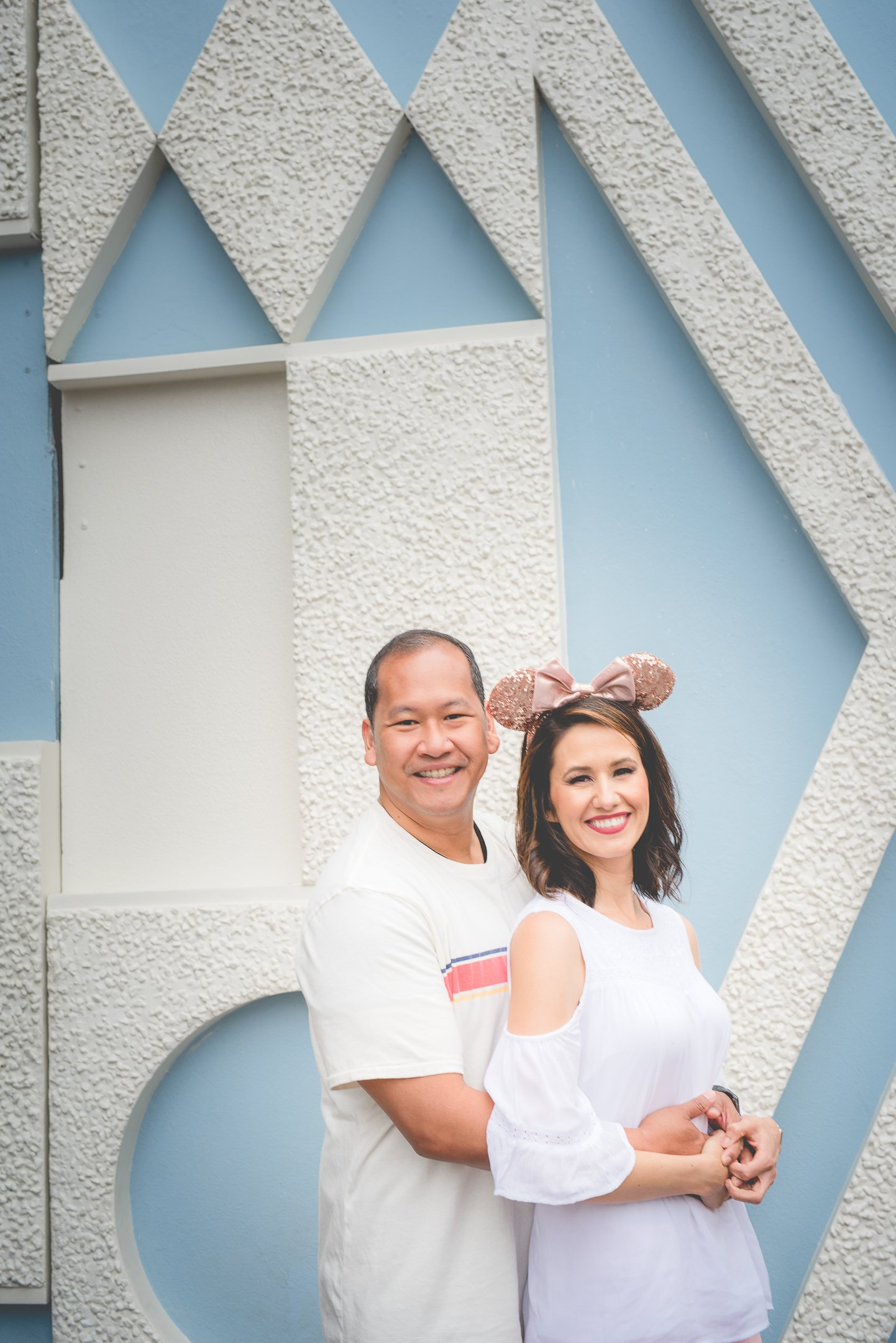 Mom and Dad photo by It's a small world ride in Disneyland, CA