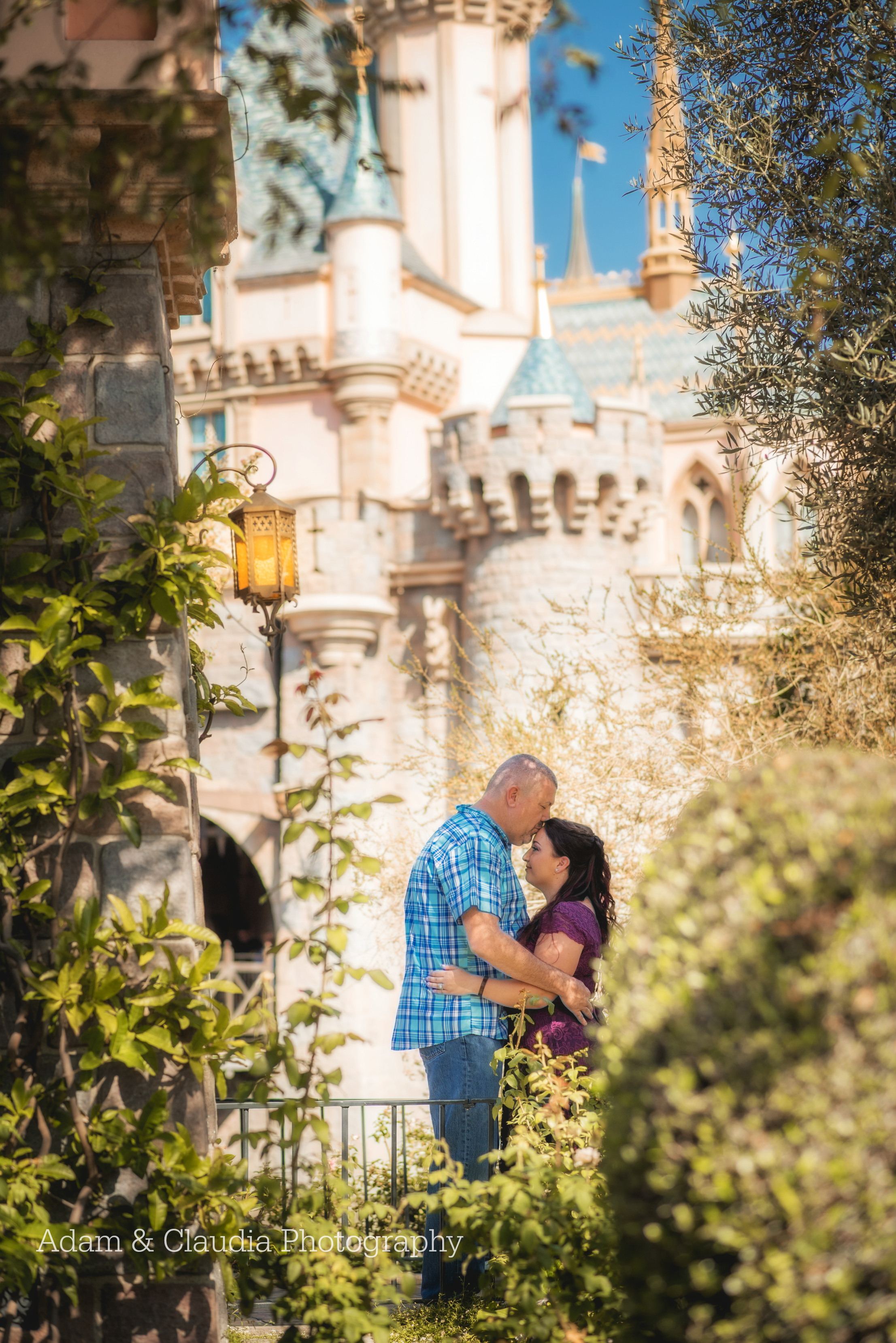 Engagement photo in front of Disney castle