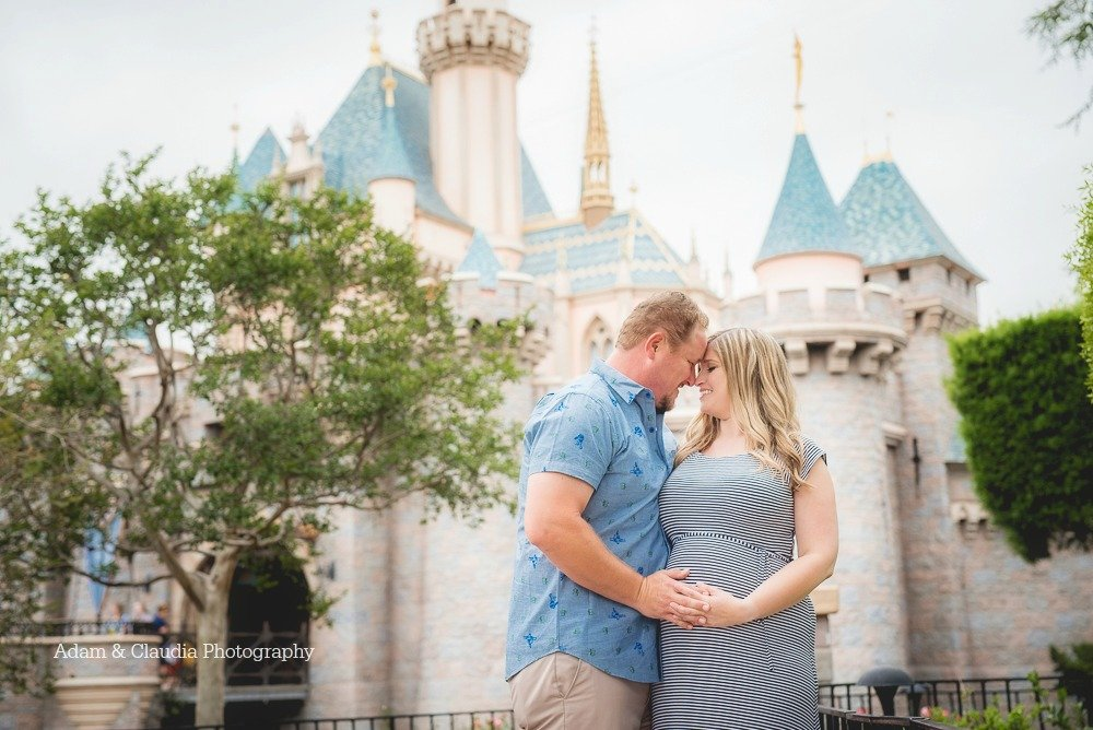 Maternity photo in front of Disney castle