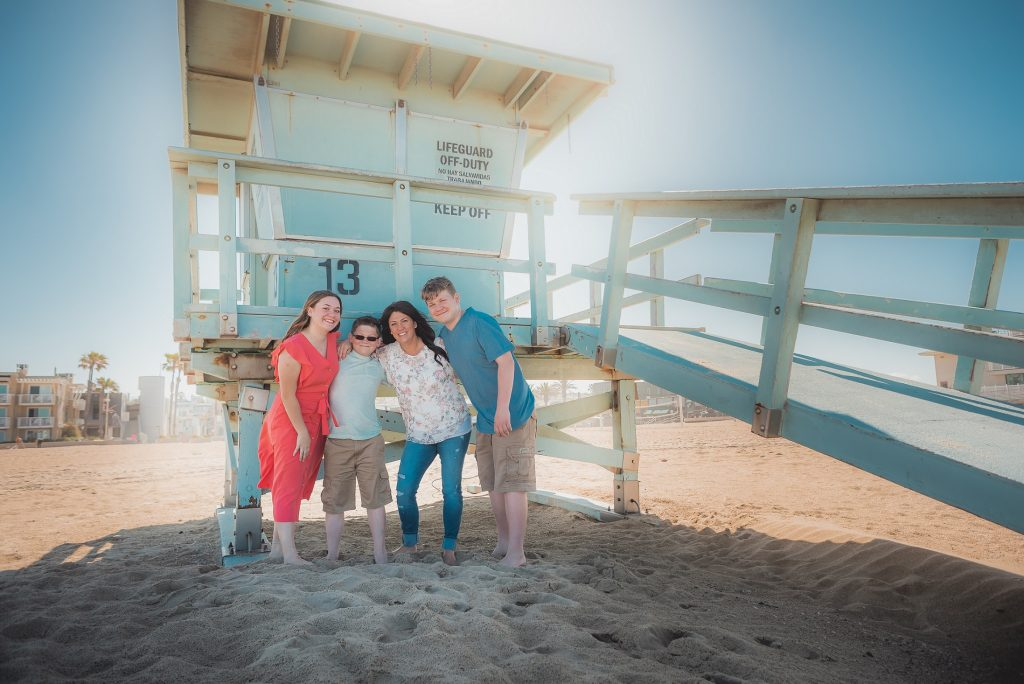 Family Portrait at the Beach under a lifeguard tower, Hermosa Beach, CA